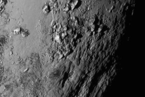 Another NASA photo of Pluto. Details are astounding.