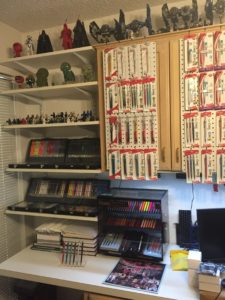 Shelves of Pentel Mechanical pencils, peg board with pencils, and legos.