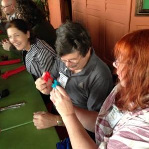 Steve Jackson and Geri Sullivan with ROCK 'EM SOCK 'EM ROBOT puppets.