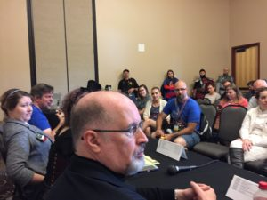 A photo of a Star Wars talk with audience and Timothy Zahn